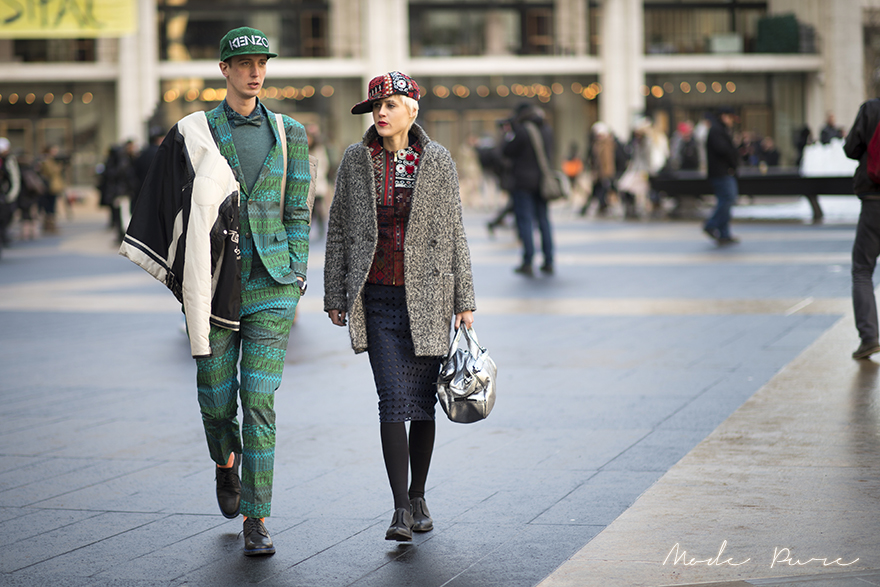 Niels Oostenbrink & Linda Tol | Kenzo cap, H&M suit, Kurt Geiger shoes; H&M cap, coat, and skirt, Alexander Wang shoes, 3.1 Phillip Lim bag | New York Fashion Week Fall/Winter 2013 | Feb 10, 2013.